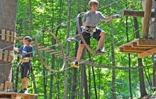 Image of boy on rope course at Catamount Adventure Park