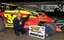 Image of person kneeling by racecar at Lebanon Valley Speedway